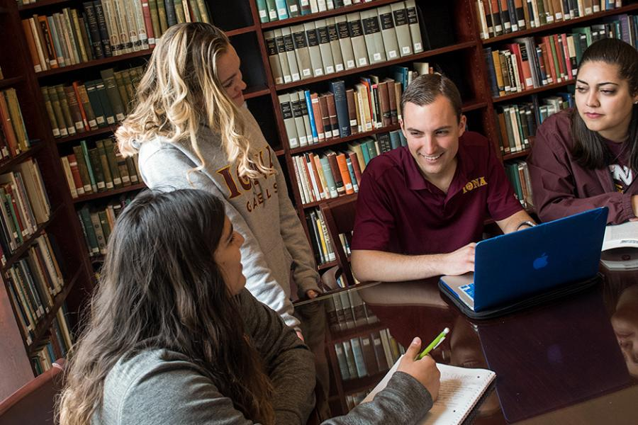 A group of English major students study together at the library.