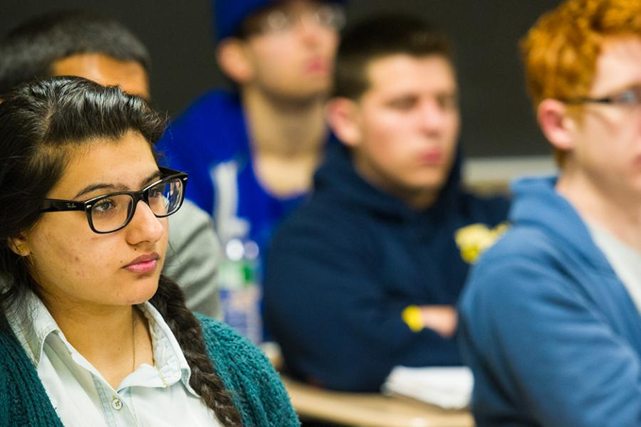 Students pay close attention in a class for business continuity.