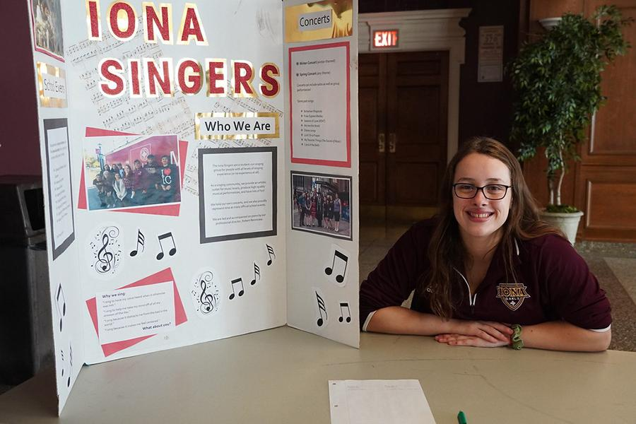 A member of the Iona Singers at their club table at the involvement fair.
