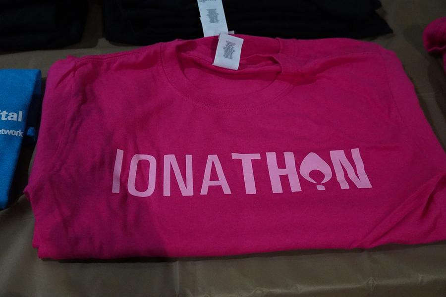 A maroon Ionathon t-shirt with pink lettering.