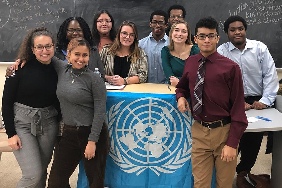 The Model UN club at one of their meetings.