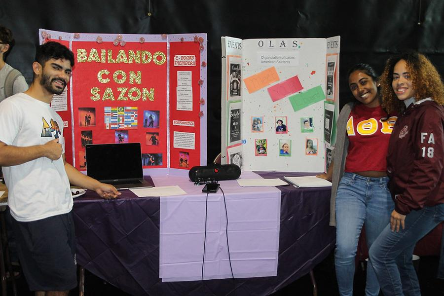 Two members of the Organization of Latinx American Students at the their table at the involvement fair.