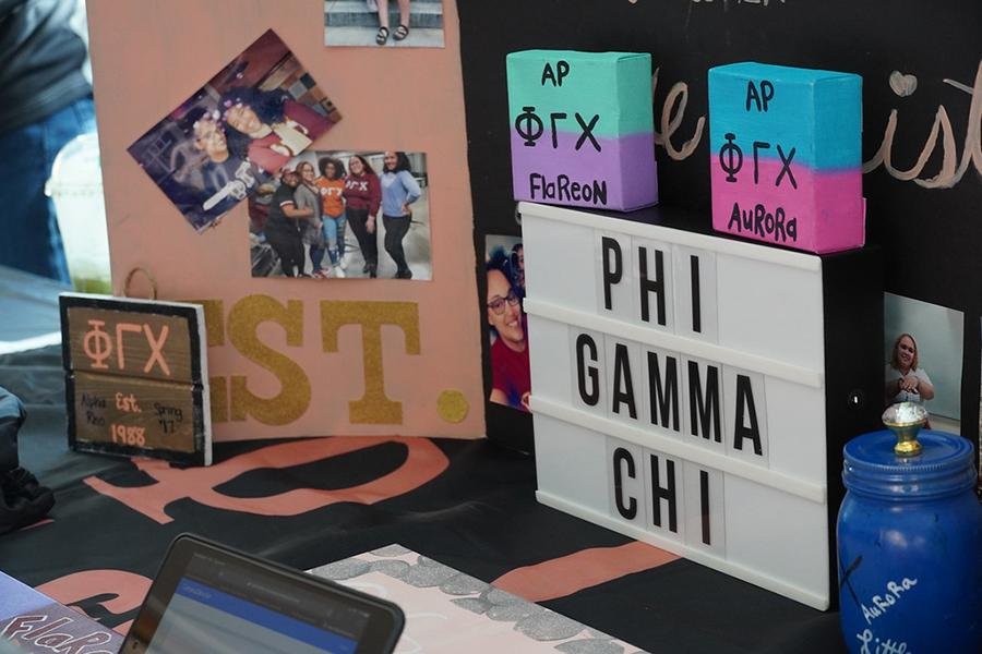 The Phi Gamma Chi table at the involvement fair.