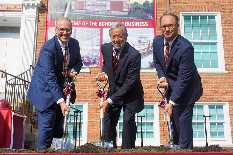 Dean Lamb, Robert LaPenta and President Nyre shovel at the groundbreaking ceremony for the LaPenta School of Business.