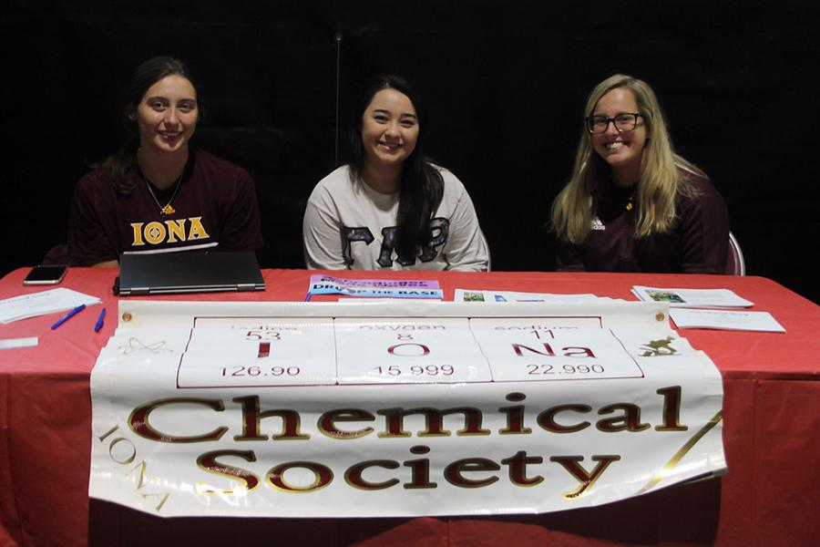 Three members of the Chemical Society recruit at their club table.
