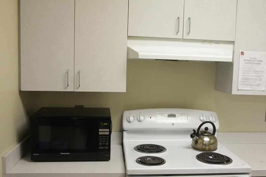 The stove and microwave area in Rice Hall.