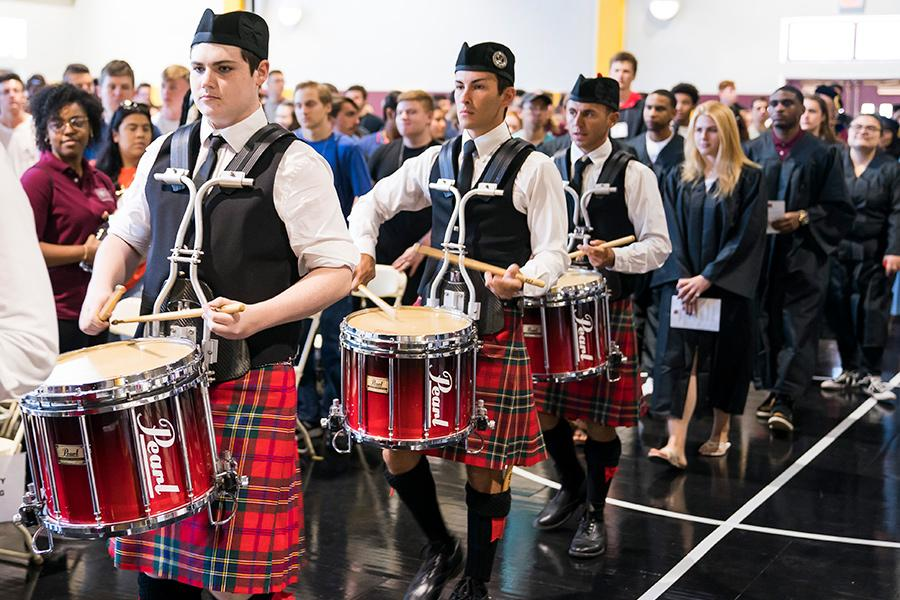 The pipers play at freshmen convocation day at the Hynes athletics center.