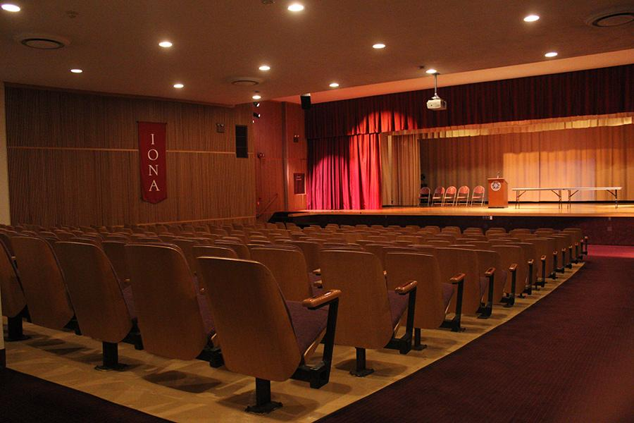 Seats in Murphy Auditorium face a large stage for performances, graduations, conferences and seminars.