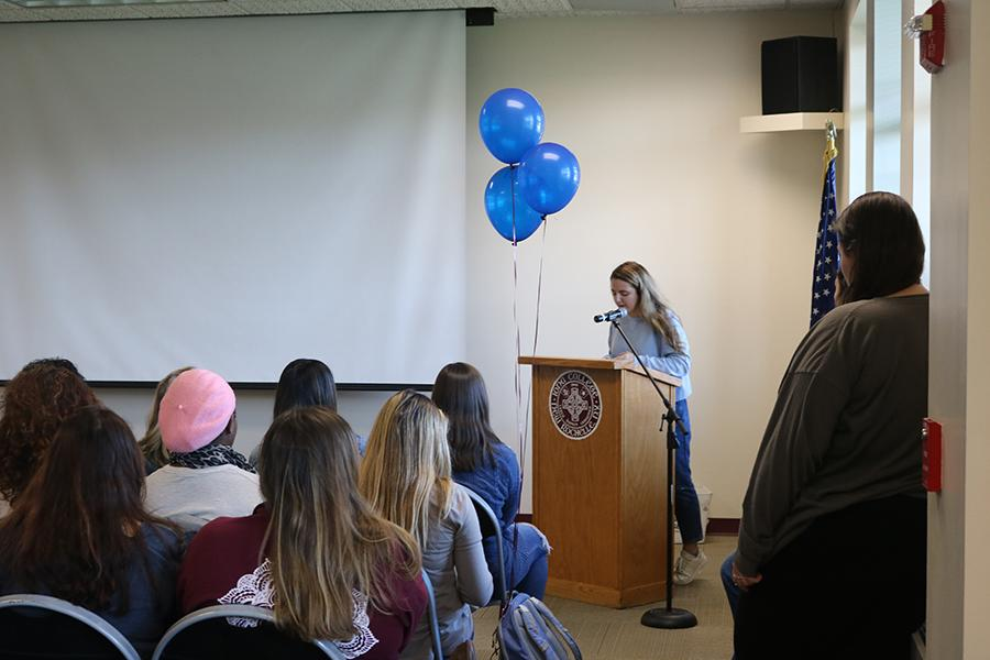 A club hosts an event in the McGrath room in LaPenta Student Union.