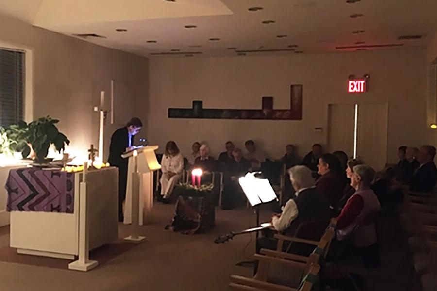 Brian Brown reads reflections at an Advent Mass held in the Iona College Chapel.