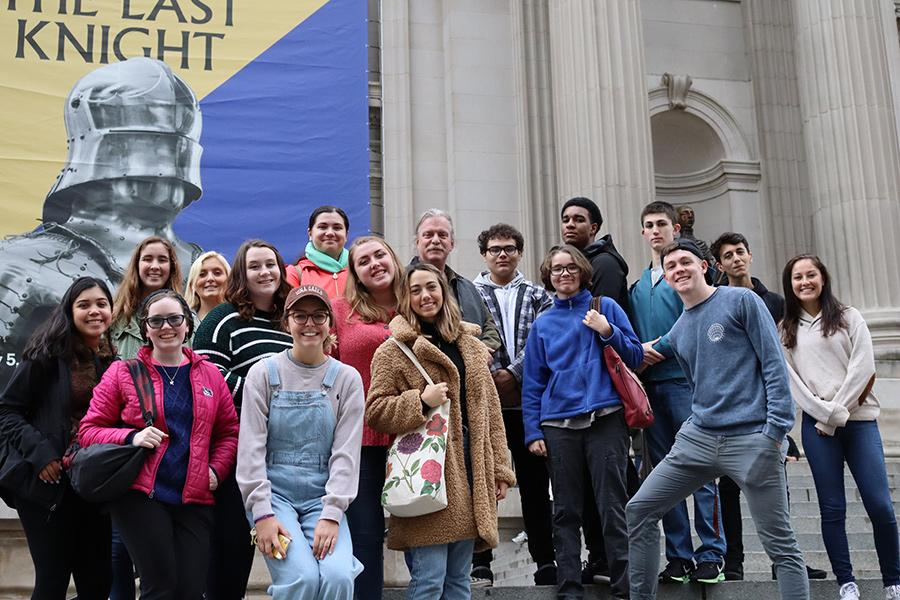 Members of the honors program meet a museum in New York City.