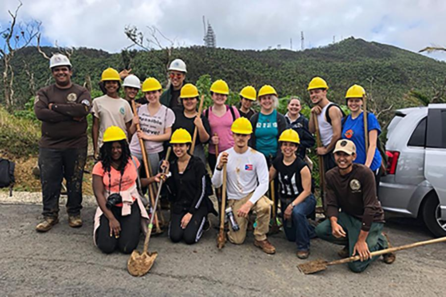 Students stand together where hard hats on the mission trip to Puerto Rico.