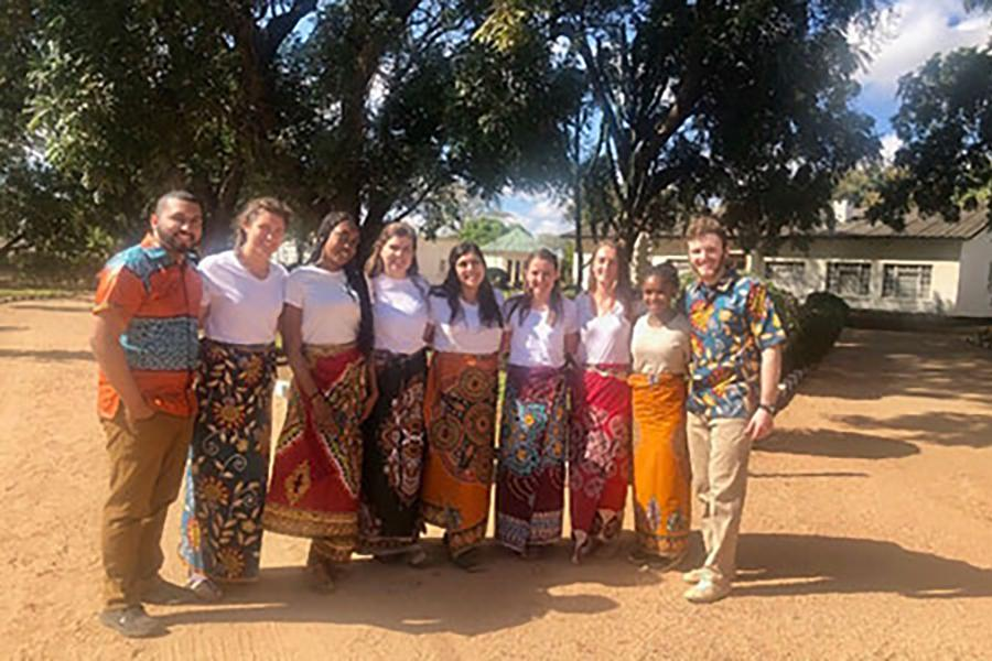 A group of students poses for a photo on a mission trip to Zambia in Africa.