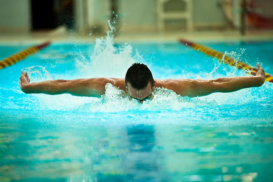 A swimmer does the butterfly stroke in the pool at Iona.