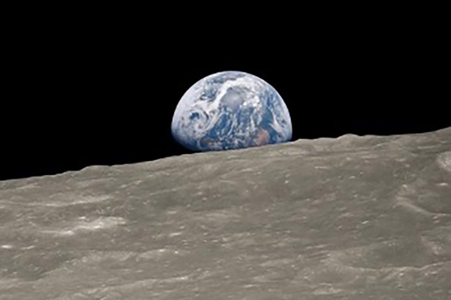 A picture of planet Earth from the perspective of the moon in space.
