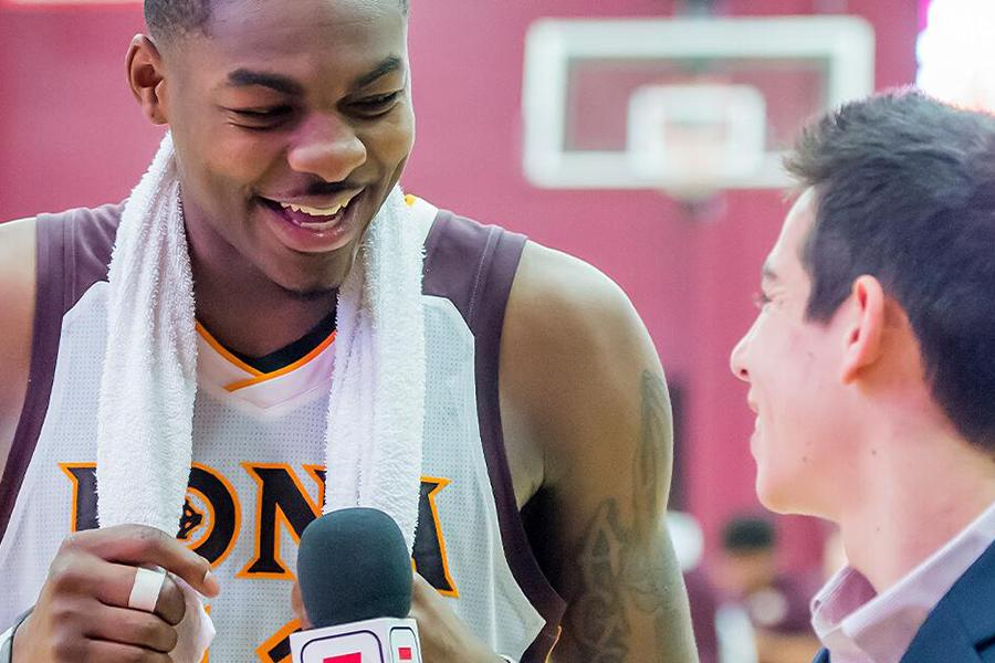 An Iona basketball player gets interviewed after the game by a Sports Comm major.