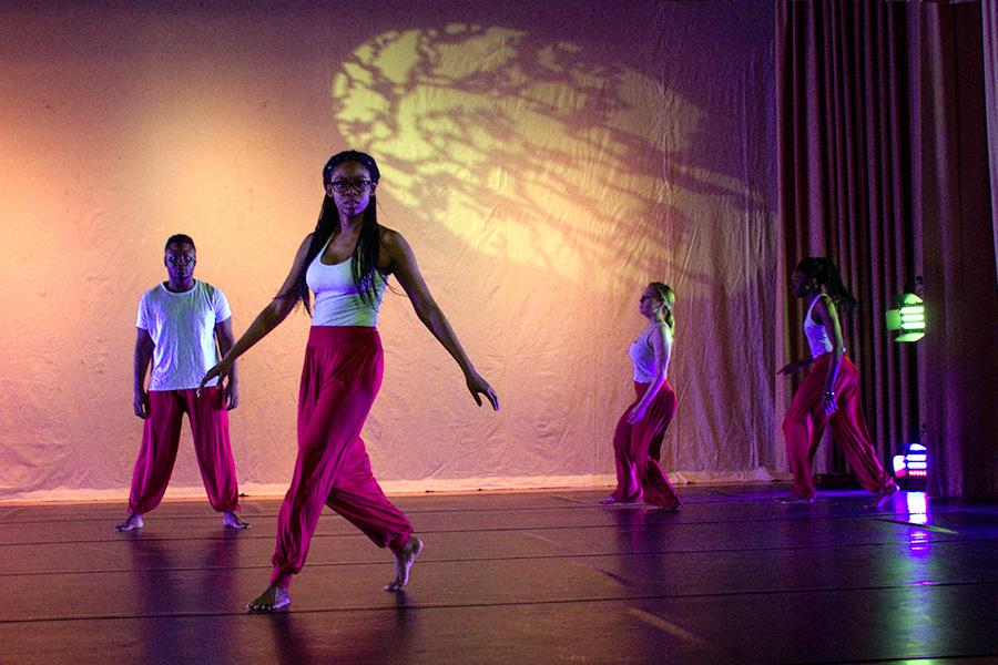 The Iona College Dance Ensemble performs on stage.