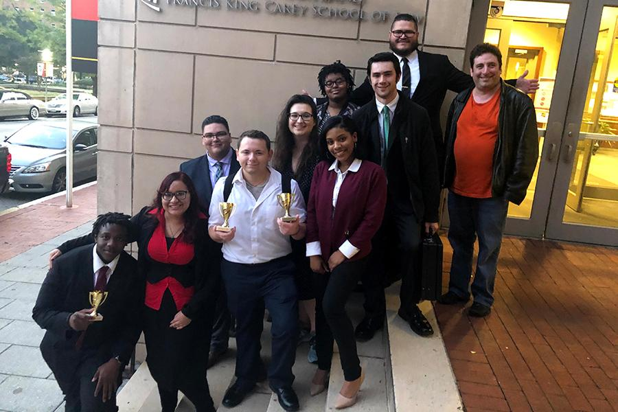A group of the Mock Trial team after winning awards at a competition.