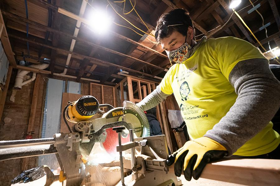 A student uses the hand saw at the Fuller house in Yonkers.