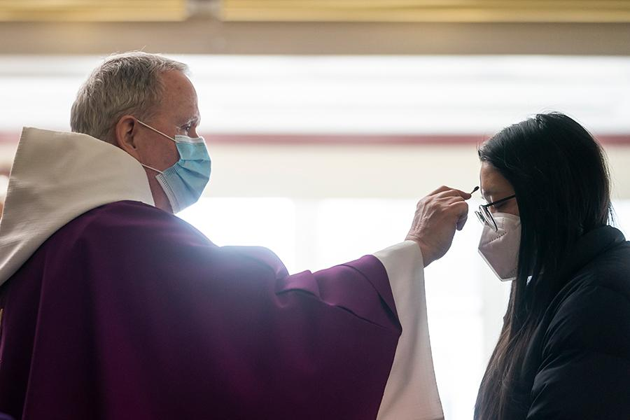Fr. Mulvey gives ashes on Ash Wednesday 2021.