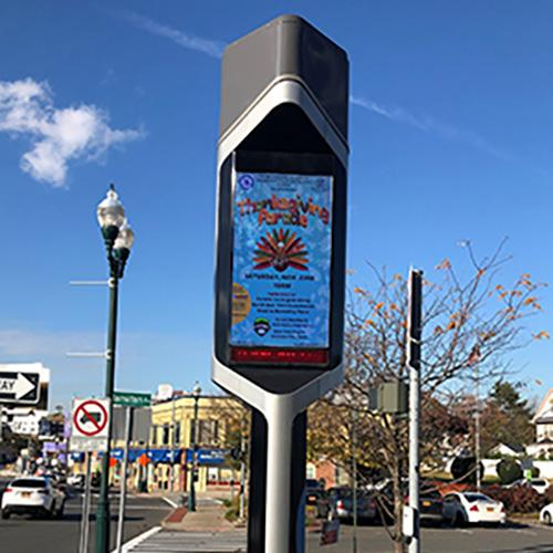 2019 Thanksgiving Parade flier on monitor in New Rochelle.