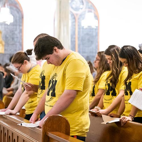 Mission and Ministry students bow their heads during the blessing.