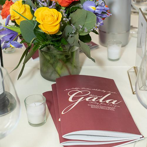 Programs and flowers on the table at the 2021 Gala.