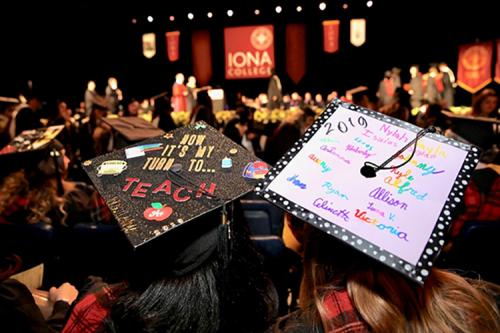 Graduates with their caps at the 2019 Commencement ceremony.