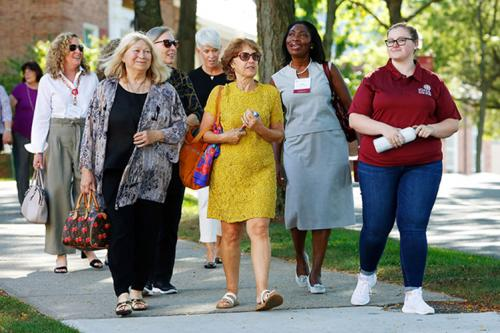Iona Alumnae take a campus tour at the 50 Years of Women kickoff celebration.
