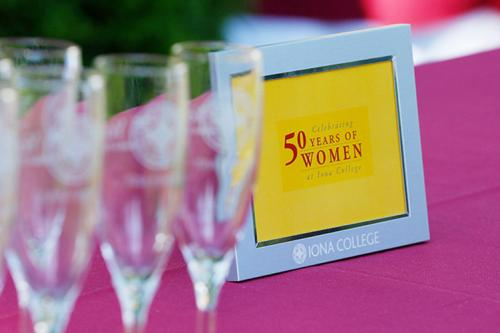 A plaque commemorating 50 Years of Women on a table at the kickoff celebration.