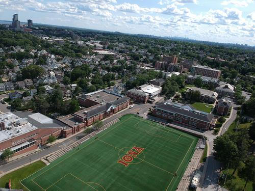 Overhead of Mazzella Field with the city of New Rochelle in the background.