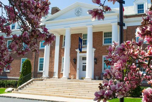 McSpedon Hall with cherry blossom trees.