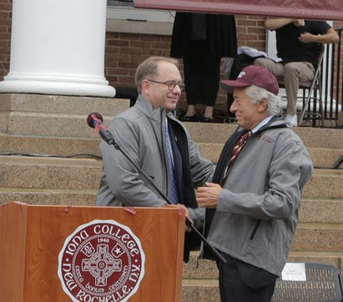President Nyre shakes hands with Robert LaPenta at the announcement ceremony for the LaPenta School of Business.