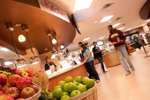 Students pick out their lunches at Vitanza Commons which has fresh fruit including different kinds of apples.